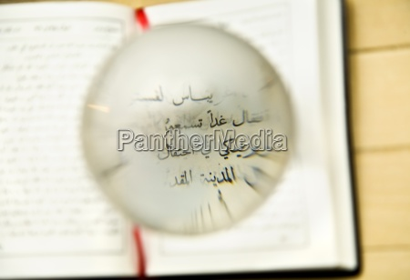 globe magnifying the new testament written