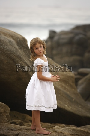 girl standing on the rocks