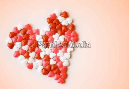 heart shaped candies forming heart shape