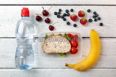 lunch box with fruits and water