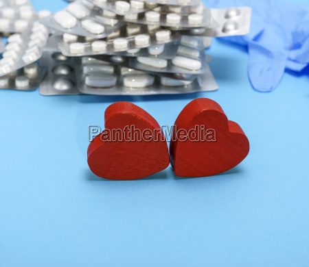 two red wooden hearts on a