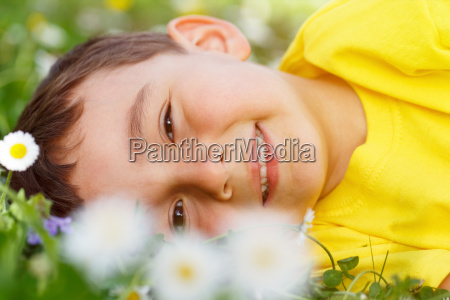 child spring flowers flower meadow young