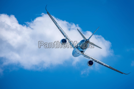 modern airliner against a sunny blue