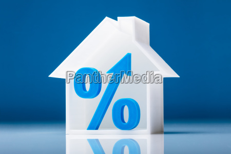 percentage symbol inside house model