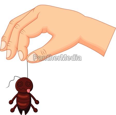 cartoon hand holding dead cockroach