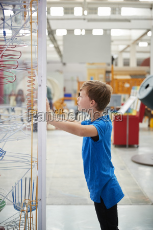 boy standing looking at a science