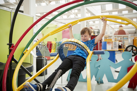 young white boy in science centre