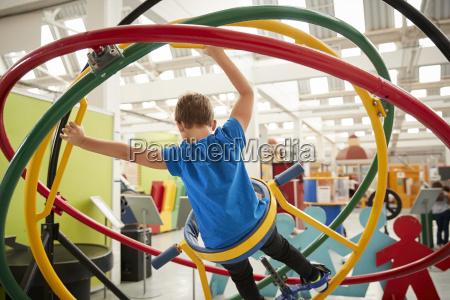 young white boy using human gyroscope
