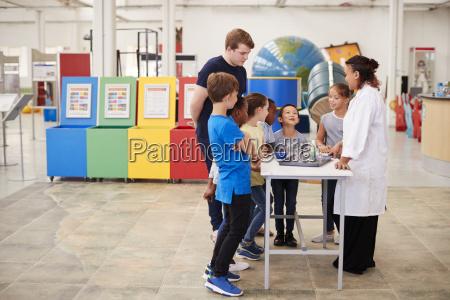 school kids watching a presentation at