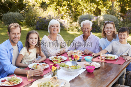 three generation family having lunch in