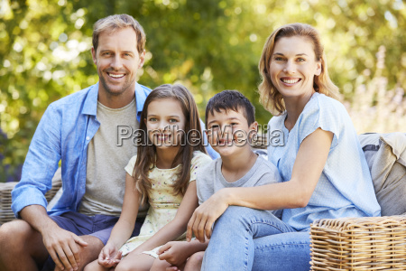 young white family sitting together in