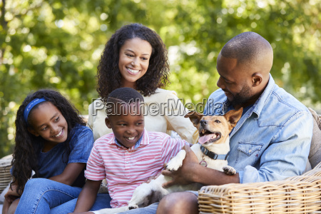 parents and two kids sitting with