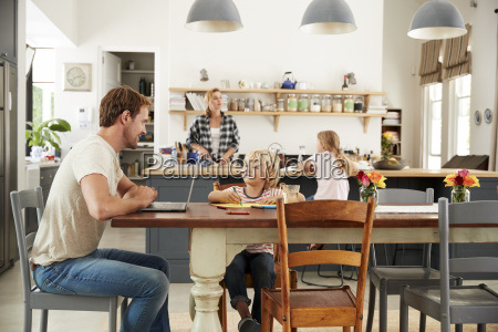 dad and son at kitchen table