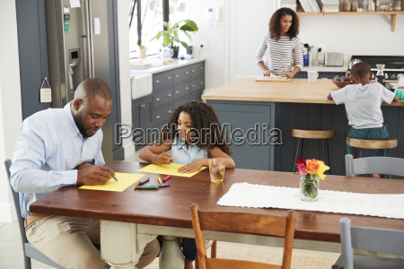 young black family busy in their