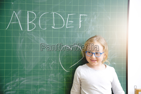 schoolgirl learns to write on the
