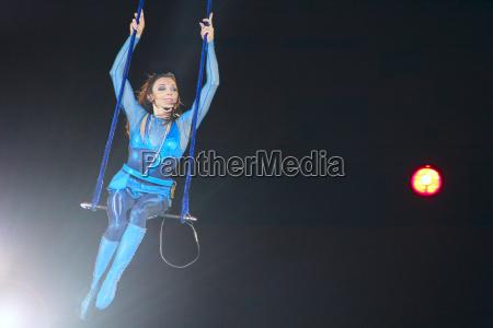 gymnast equilibrist under circus dome