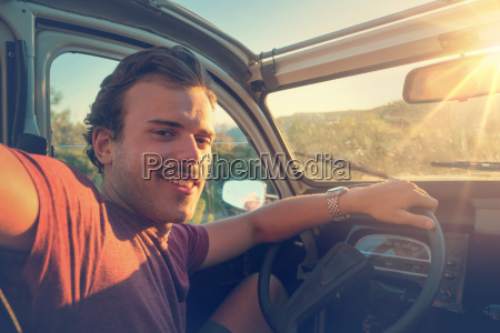 young man in a car at