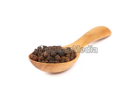 wooden scoop spoon full of black