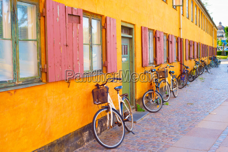 bycicles old building wall copenhagen