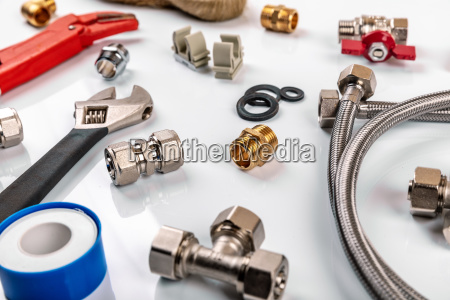 plumber tools and equipment on white