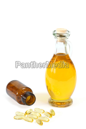 vitamin capsules with oil bottle