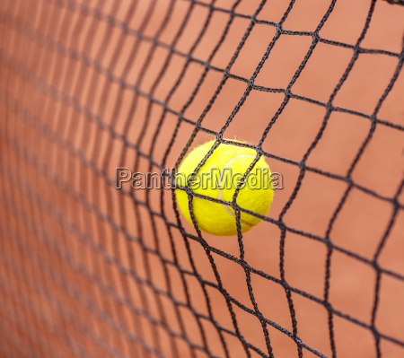 tennis ball hitting to net