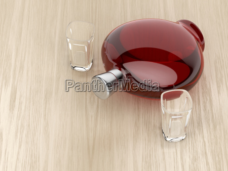 liqueur bottle and two glasses