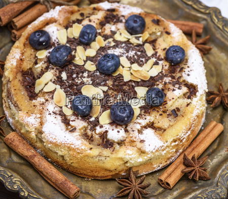 baked round cake with blueberries