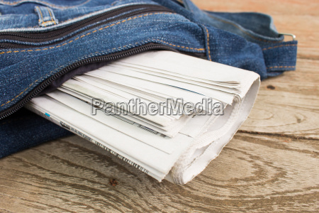newspaper in newspaper bag on wood