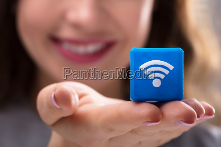 woman holding cubic block with wireless