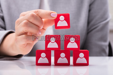 businesswoman building blocks of a team