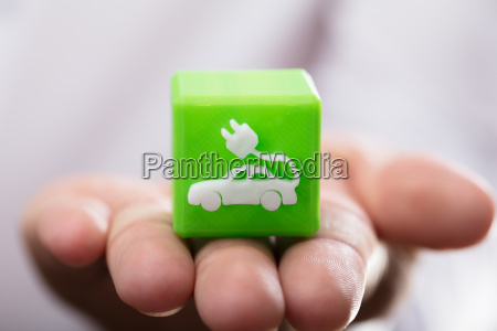person holding cubic block with eco