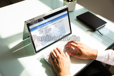 elevated view of businessman doing online