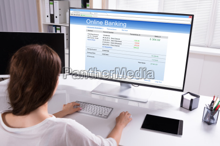 businesswoman doing online banking on computer
