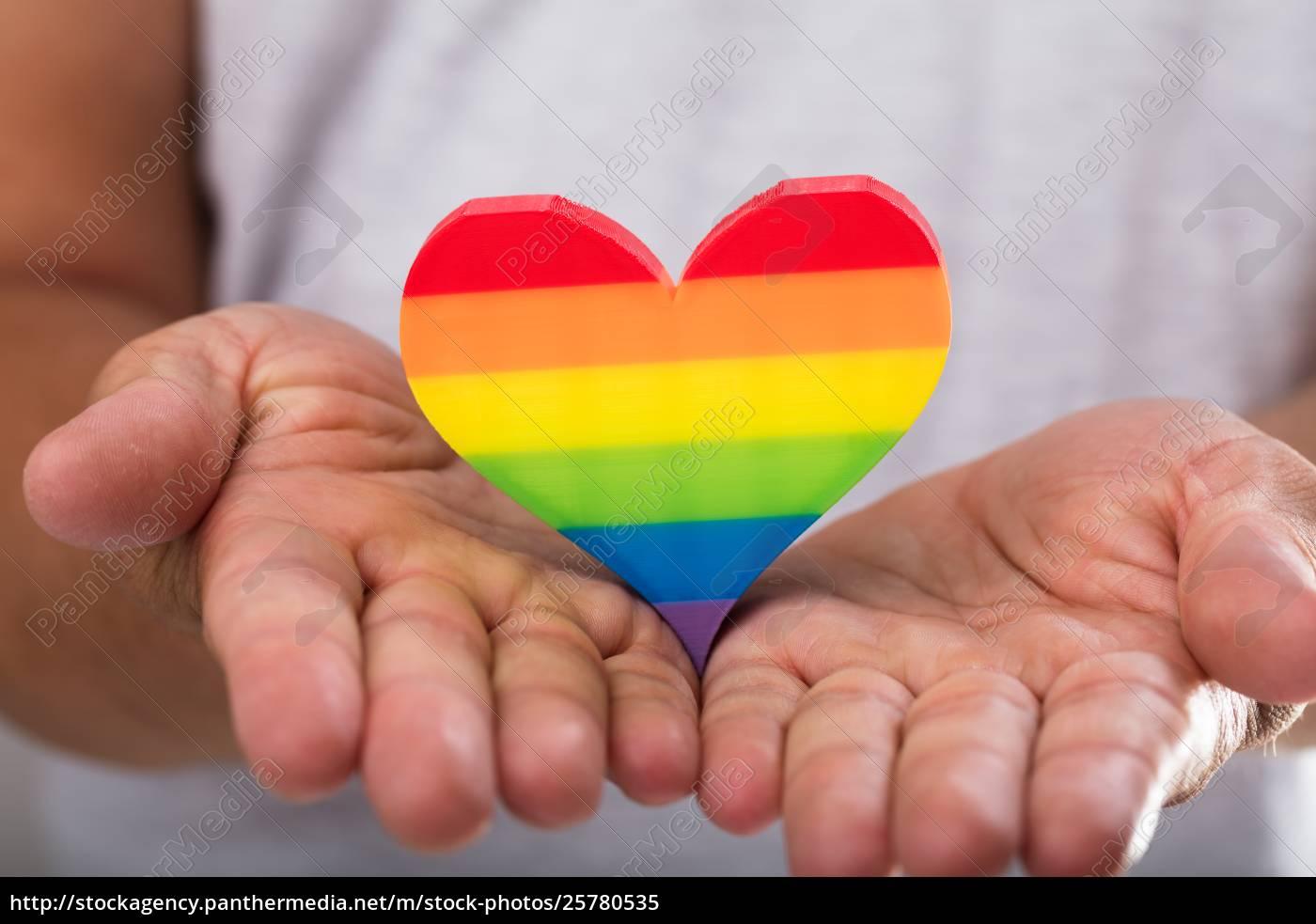 man, holding, rainbow, lgbt, heart - 25780535