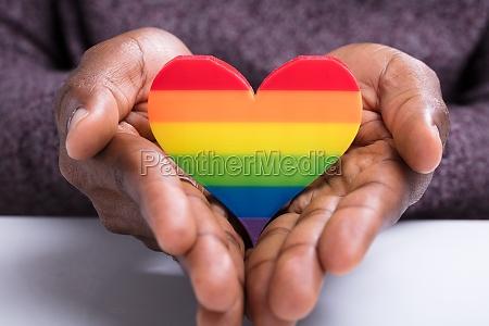 rainbow heart on the mans hand