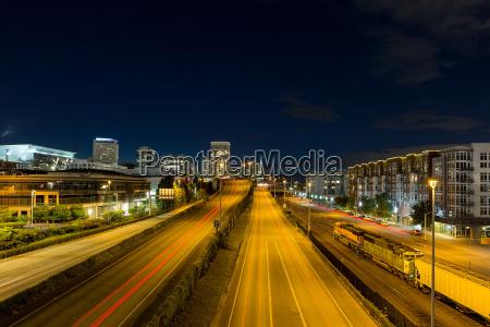 freeway traffic light trails in downtown