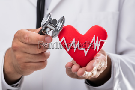 doctor examining red heart rate with