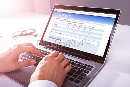 businessman filling online survey form on