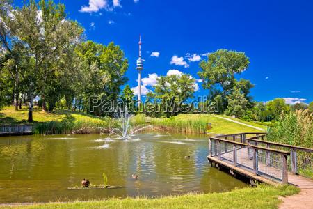 donaupark lake fountain and donauturm tower