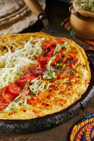 preparing traditional regional ugandan street food