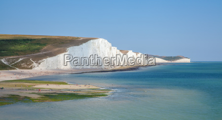 seven sisters cliffs seascape and people
