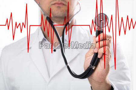 doctor examining heart rate with stethoscope