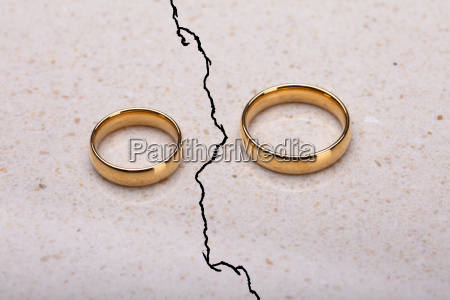 two separated wedding rings