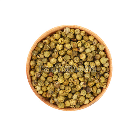wooden bowl full of green peppercorns