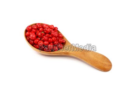 wooden scoop spoon full of pink