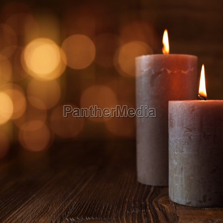 burning candles and golden lights