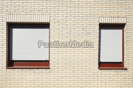 windows with closed shutters on a