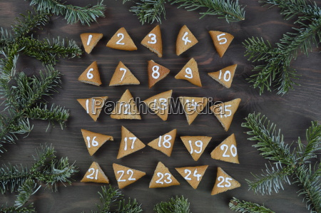 25 numbered advent cookies on brown