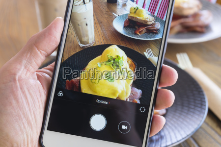 taking picture of breakfast with smartphone